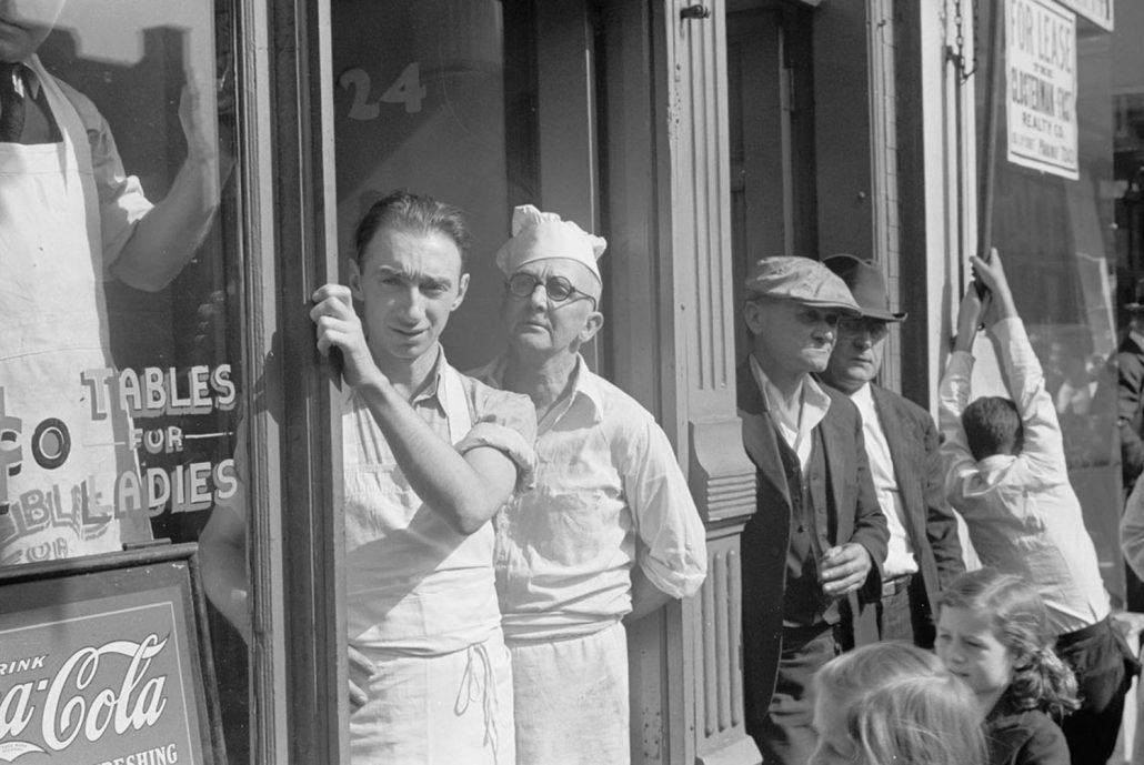 Solomon Hess SBA Loan Fund – Men outside shop